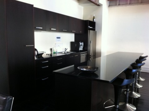 The sleek modern high-end glossy black furniture at Loft503